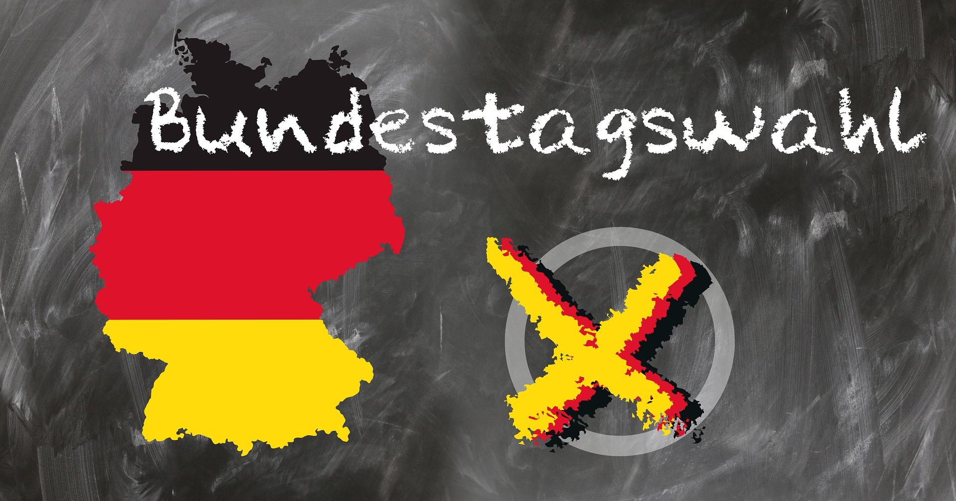 Deutschland in den Nationalfarben mit nebenstehendem Wahlkreuz